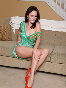 Tempting cougar Danielle Reage loves to hang out on her sofa with a vibrator drilling her pierced pu