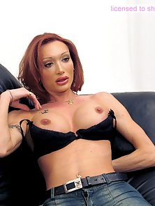 Alluring redhead t-lady displays her humongous cock