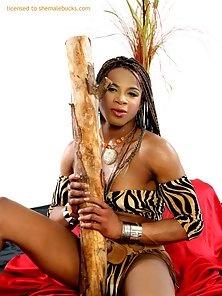 Busty black chick with huge thick dick in tribal outfit
