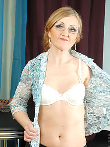 Anilos grandma in glasses fucks her tender pussy with a rubber dildo and cleans it with her mouth
