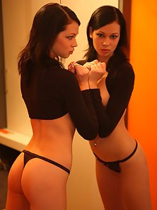 Brunette young babe with a fit body showing her sexy thong