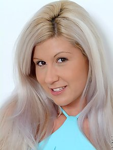 Sweet teenie blond andrea shows off her small tits taking off her blue top