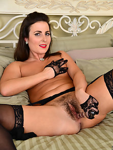 Fantastic Brunette in Lingerie and Stocking Masturbates