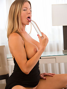 Elegant housewife spreads her delicious shaved pussy and fucks a toy