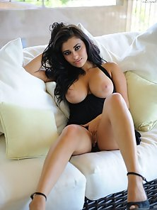 Chesty Babe Gets Naked On The Couch