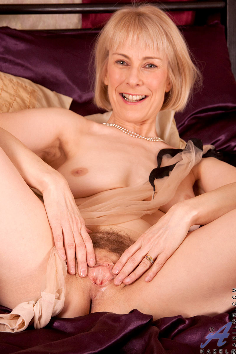 Mature on bed in solo action