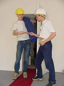 Construction boys oiling each other hard tool