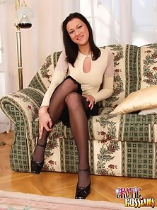 Raven haired Russian vixen in stockings fingering her yummy beaver
