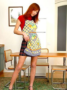 Redhead teen beauty posing on a table