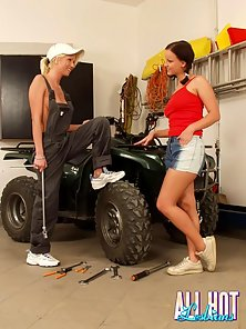 Two slutty lesbian honeys licking their petite pussies in the garage