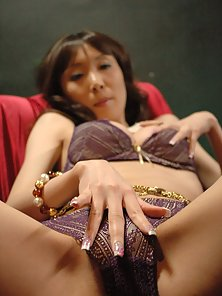 Horny Asian slut is putting a tarzan toy in her hairy cunt
