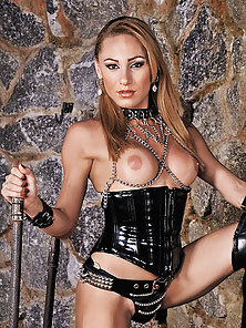 Shemale mistress Mylena shows off in leather