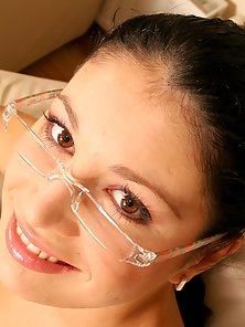 Cute teen with glasses enjoys his sticky cum on her face