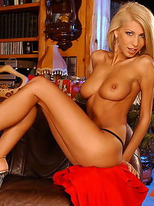 Huge titted blonde posing and dildoing herself