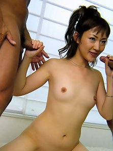 Hairy Japanese sucks two dicks and gets spunked in her twat