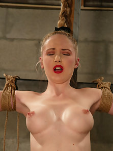 Chanta tied to a cross and licked to orgasm.