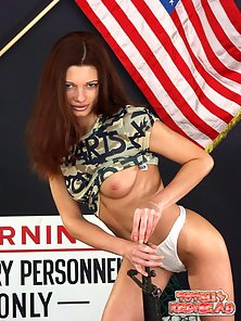 Ultra sexy redheaded soldier stripping and showing her tiny pussy