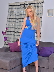 Long legged blonde milf wiggles out of her evening dress to massage her swollen clit