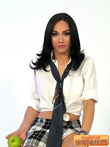 Raven haired shemale stripping lascivious and showing her round boobies