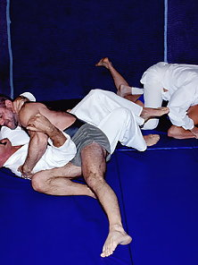 Four raunchy wrestlers punish their partners forcing them to the mat.
