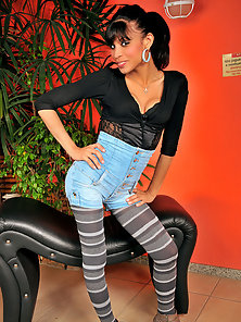Shemale cutie in striped pantyhose in action
