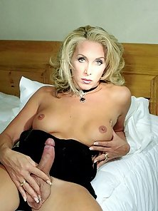Curly shemale Christie showing her massive pecker
