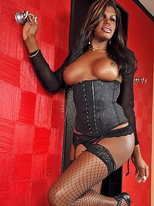 Black tgirl shows off in stockings and heels