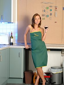 Wearing only an apron in this sexy kitchen session
