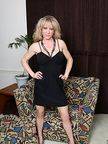 Big tit MILF can't wait to strip down and play