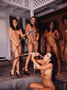 Fabulous babe in the middle of a squirt orgy