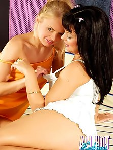 Two playful lesbian honeys licking their perky boobies with lust
