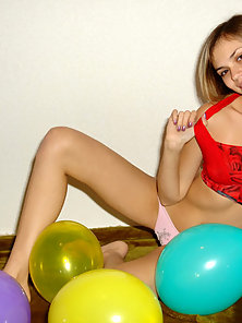 See this shining teen model strips off to play naked with her balloons