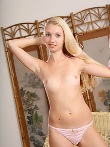Blonde teen absolutely naked indoors showing her ass and tits