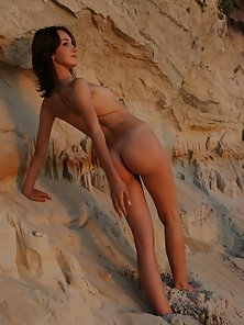 Teeny posing naked in the mountains