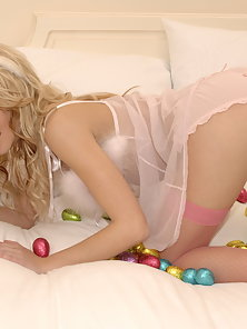 Stunning young blonde masturbates her pussy with chocolate eggs