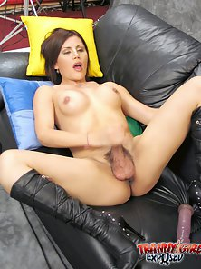 Brunette Tranny with Small Tits Suck Dildo on Black Couch