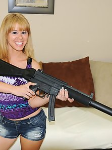 Cute little blond teen goes to the shooting range and then sucks off her boyfriend