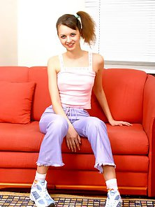Ponytail Brunette Fondle Her Pussy by Herself on Red Couch