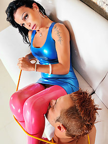 Carla Novaes is naughty in blue and pink latex