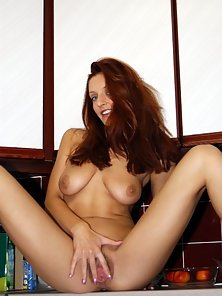 Redhead with Trimmed Snatch Posing in Thongs