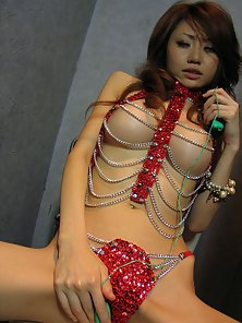 Japanese chick with silicone tits toying her hairy slit