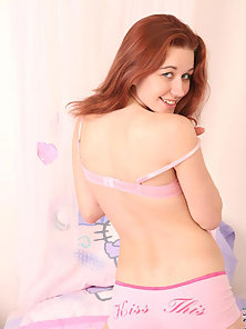 Redhead Teen in Bed Strips and Poses Sexily