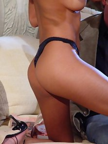 Hot ebony babe seducing two horny guys on couch