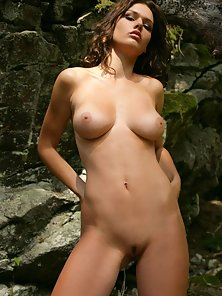 Sweet brunette babe showing her naked firm body outdoor
