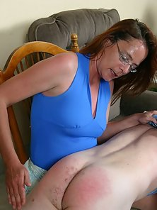 Horny MILF spanks her husbands ass raw