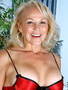 Sexy Anilos cougar Veronica wears red lingerie as she starts to masturbate with a dildo on the sofa