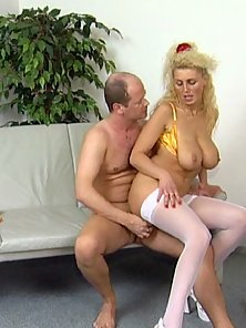 Slutty MILF with big, meaty tits is sucking dick and enjoying some deep pussy penetration.