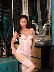 Delicious mommy wears tempting pink lingerie and stockings