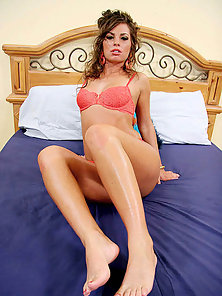 Petite brunette cutie rubs a thick cock hard with her red painted toes