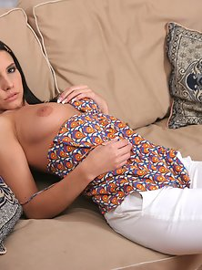 Gorgeous brunette fingers sweet pussy on couch